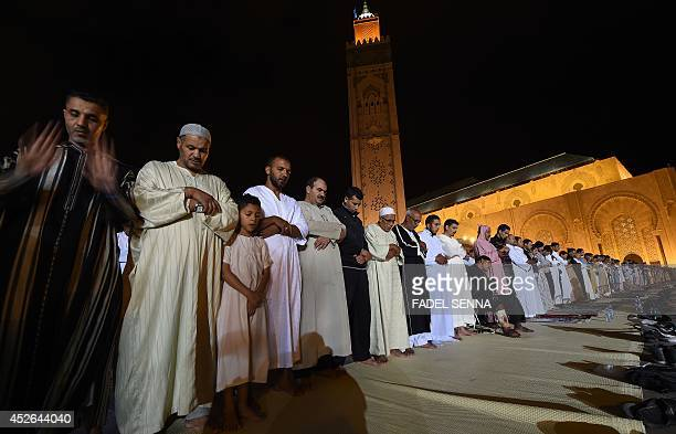 Moroccan Muslim men pray at Hassan II mosque in Casablanca late on July 24 2014 during the Lailat alQadr which falls on the 27th day of the holy...
