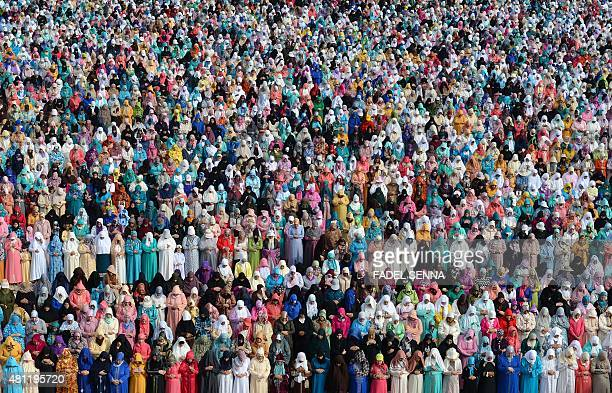 Moroccan Muslim women perform prayers for Eid alFitr which marks the end of the Muslim holy fasting month of Ramadan in the city of Sale north of the...