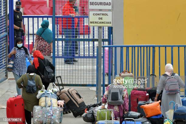 Moroccan nationals, stranded in Spain since the closure of borders in mid-March to tackle the coronavirus, go through customs prior to crossing the...