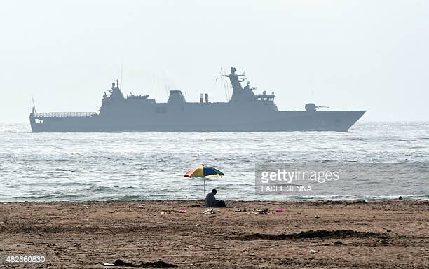 A Moroccan navy boat patrols off the beach near Cap Spartel in Tangier on August 3 2015 Saudi King Salman has arrived in Morocco from southern France...