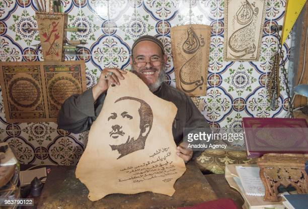 Moroccan Omer alHadi poses for a photo with the calligraphy of Turkish President Recep Tayyip Erdogan after his presidential election success in...