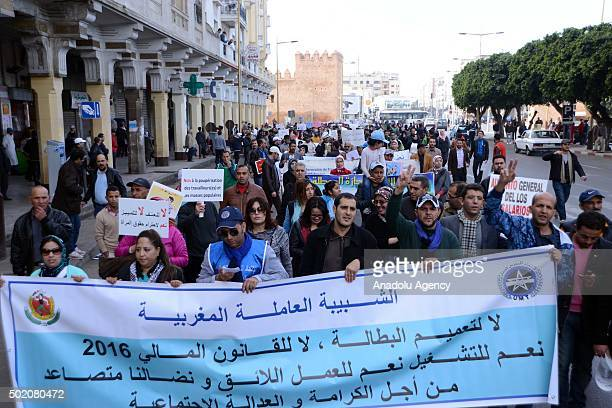 Moroccan people hold banners during the demonstration 'Fight against Unemployment' organized by National unity front against Unemployment at Mohammad...