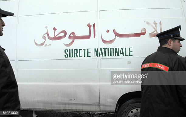 Moroccan police officers secure on January 9 2009 a van bringing some of 33 alleged Islamists including BelgoMoroccan Abdelkader Belliraj the alleged...