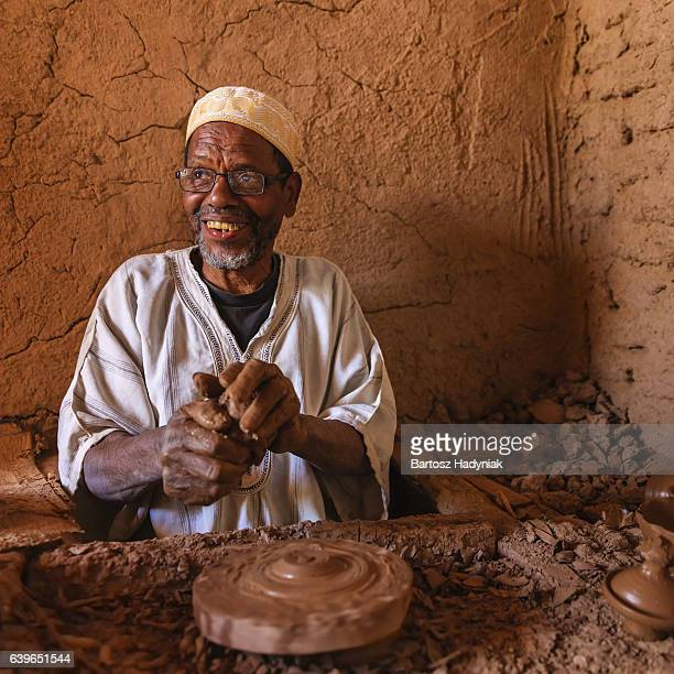 Moroccan potter working in his workshop