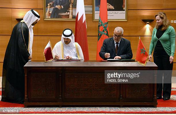 Moroccan Prime Minister Abdelilah Benkirane and his Qatari counterpart Sheikh Abdullah bin Nasser bin Khalifa alThani sign a cooperation accord...