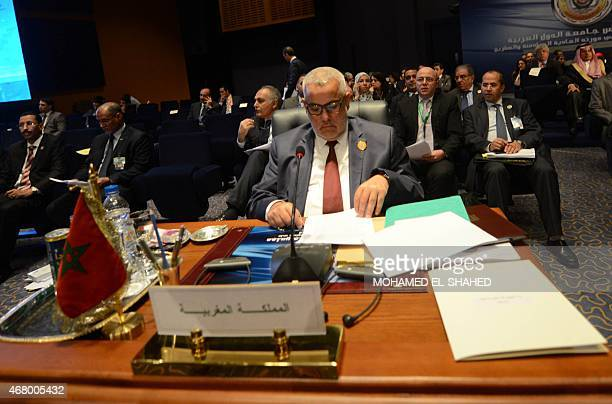 Moroccan Prime Minister Abdelilah Benkirane attends the closing session of the Arab League summit in the Egyptian Red Sea resort of Sharm ElSheikh on...
