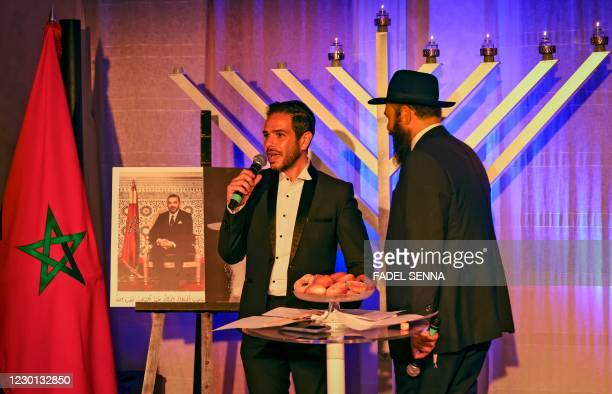 Moroccan Rabbi and a member of Casablanca's Jewish community are pictured during a ceremony on the fifth night of the Jewish holiday of Hanukkah on...