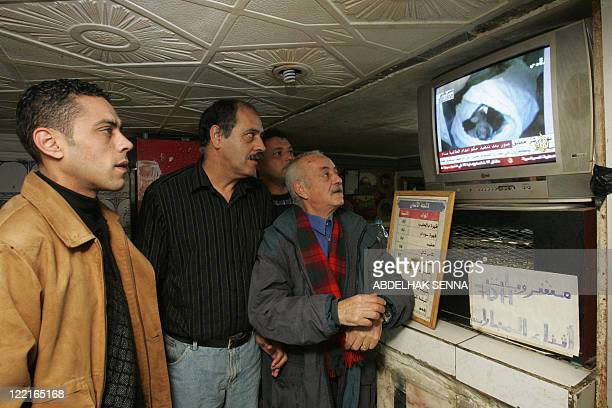 Moroccan residents watch images of Iraqi private television Biladi showing the dead body of Saddam Hussein draped in a white shroud in the hours...