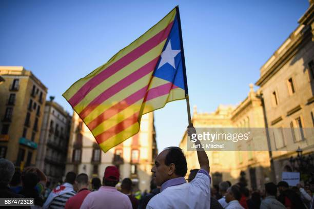 Moroccan Rif activists holds a Catalan independence flag during a demonstration outside the Palau Catalan Regional Government Building on October 28...