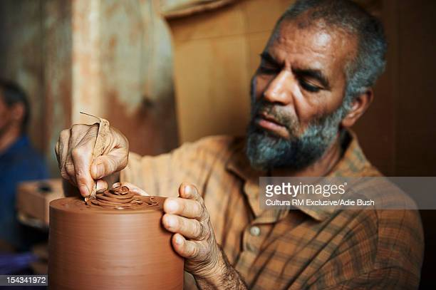 Moroccan sculptor working with clay