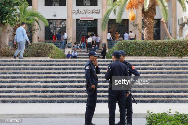 Moroccan security forces stand guard outside a court during the trial of Hajar Raissouni a Moroccan journalist of the daily newspaper Akhbar ElYoum...