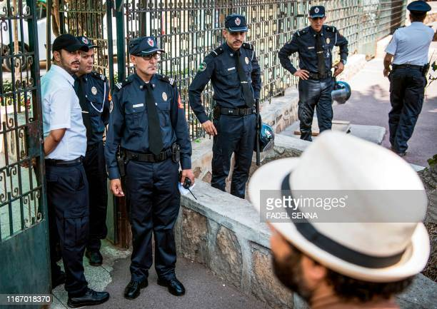 Moroccan security forces stand guard outside a courthouse holding the trial of Hajar Raissouni a journalist of the daily newspaper Akhbar ElYoum on...