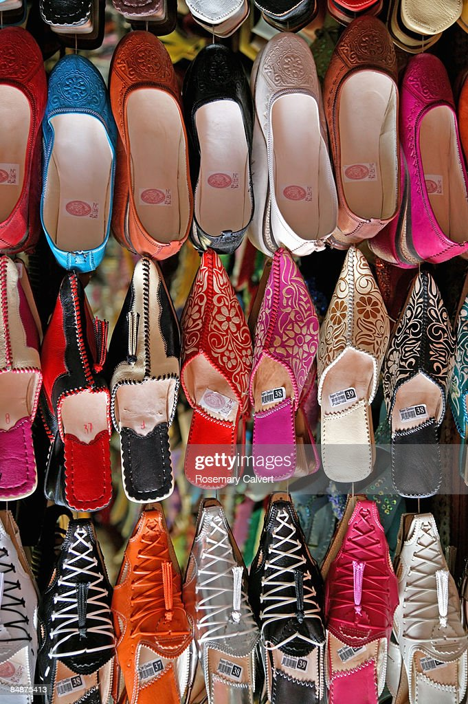 ced77bbf1d8 Moroccan shoes and slippers in street market.   Stock Photo