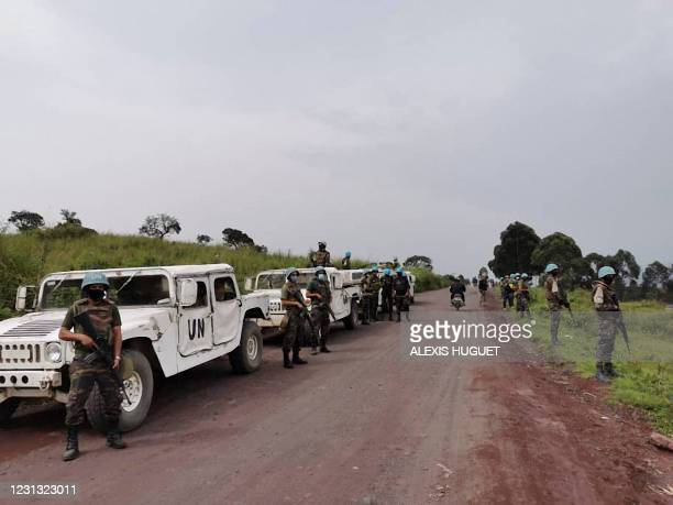 Moroccan soldiers of the MONUSCO patrol the road in the Kibumba area in the Virunga National Park, 25km from Goma, on February 22 where Italy's...