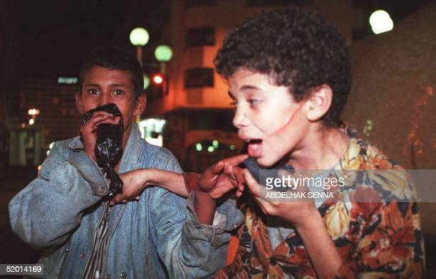 Moroccan street childrren sniff glue in a street of Casablanca 09 October Some 4000 homeless children aged between eight and 16 haunt the economic...