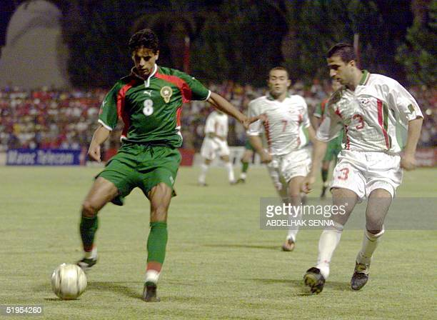 Moroccan striker Said Siba vies with Algerian defender Mariana Youssef in Fes 09 July 2000 during their second round match for the 2002 World Cup...