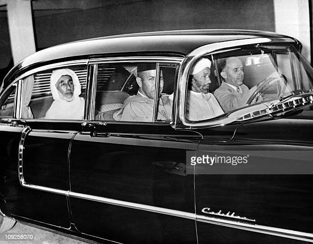 Moroccan Sultan Sidi Mohammed ibn Arafa is photographed in Rabat driving from the Imperial Palace in his Cadillac on September 26 1955 for the first...