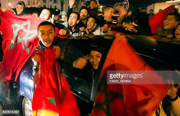 Moroccan supporters celebrate a victory after the end of the 2017 Africa Cup of Nations group C football match between Morocco and the Ivory Coast in...