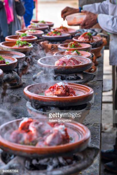 moroccan tajines with vegetables and meat (hdri) - moroccan culture stock photos and pictures