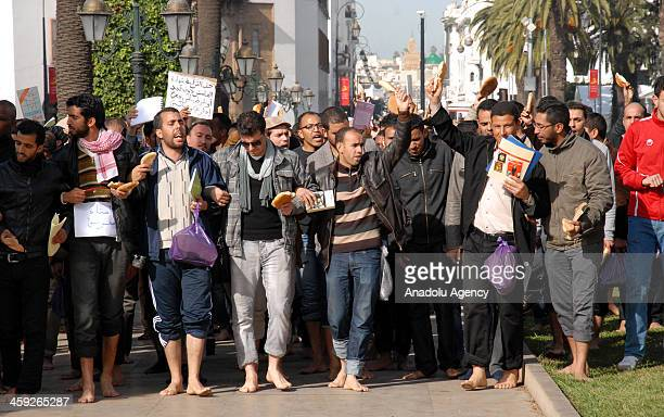 Moroccan teachers walking barefoot stage a demonstration to demand wage promotion on December 24 2013 in Rabat the capital of Morocco