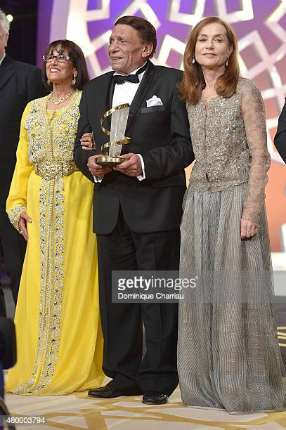 Moroccan theatre director actress and politician Touria Jabrane Egyptian movie and stage actor Adel Emam and jury president Isabelle Huppert on stage...