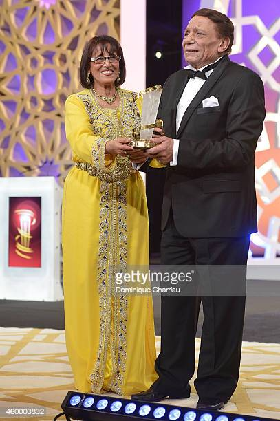 Moroccan theatre director actress and politician Touria Jabrane presents Egyptian movie and stage actor Adel Emam with a tribute award during the...