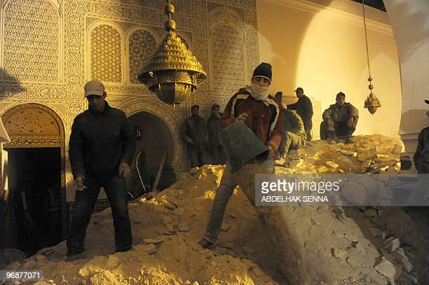 Moroccan volunteers of the 'Medina' help rescue workers to look for survivors and bodies after the minaret of a mosque collapsed during weekly Friday...