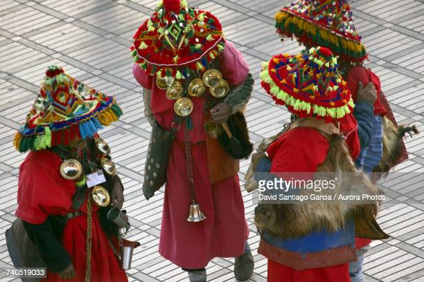 moroccan water sellers in traditional clothing - djemma el fna square stock photos and pictures