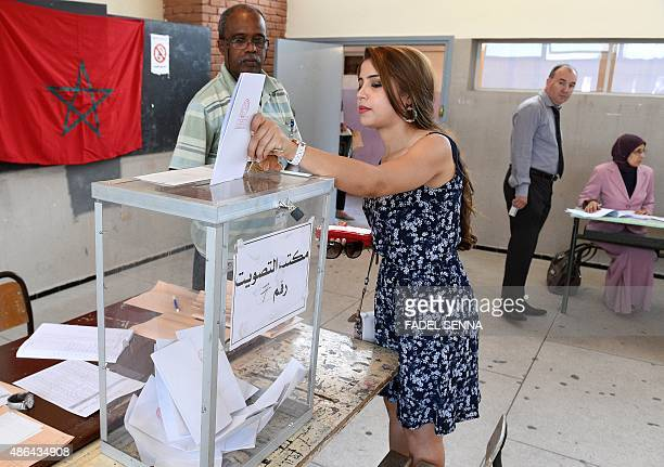 A Moroccan woman casts her vote in the local elections at a polling station in the centre of the Moroccan capital Rabat on September 4 2015 Some 15...