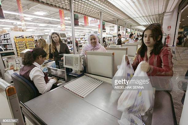 A Moroccan woman checksout at the supermarket in Rabat on April 4 2008 During the first two months of 2008 prices in Morocco have risen cooking oil...