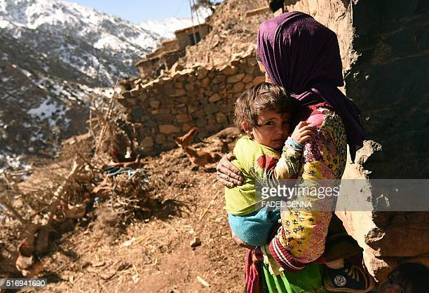 A Moroccan woman comforts her crying grandchild in Taghzirt an isolated village in the elHaouz province in the High Atlas Mountains south of...