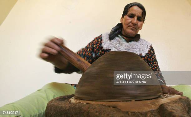 Moroccan woman crushes Argan tree nuts 18 June 2007 in Smimmou near Essaouira to make Argan oil The Argan tree is unknown for many people since it...