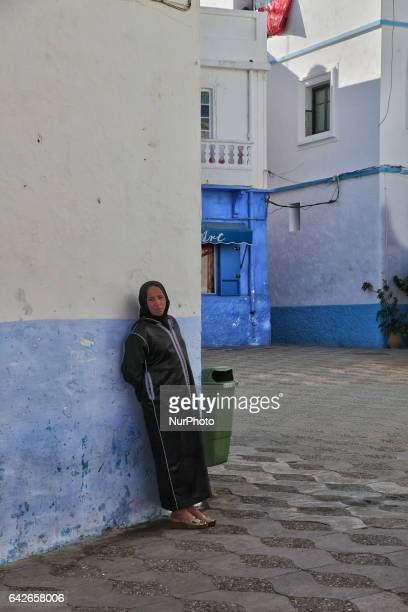 Moroccan woman in one of the many laneways in the coastal town of Asilah Morocco Africa