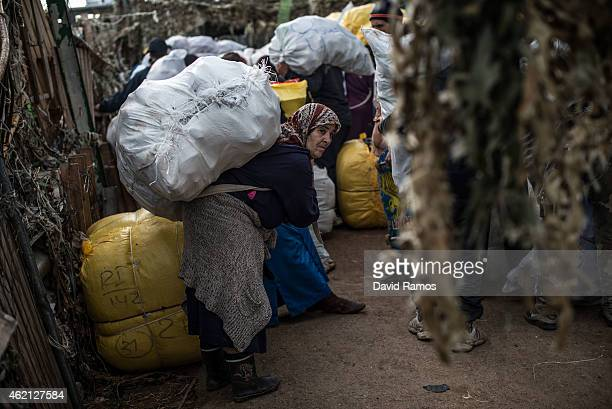 A moroccan woman wait with her package on her back at the 'Barrio Chino' border crossing point between Melilla and Morocco on January 20 2015 in...