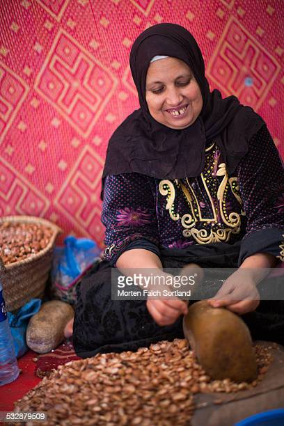 Moroccan woman working at a cooperative Argan oil factory on the countryside of Morocco
