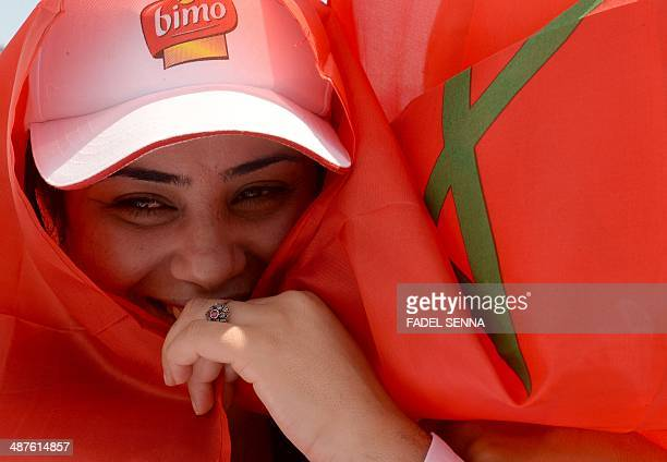 A Moroccan woman wrapped in her national flag takes part in a rally organized by the Moroccan Unions and marking the International Labour Day on May...