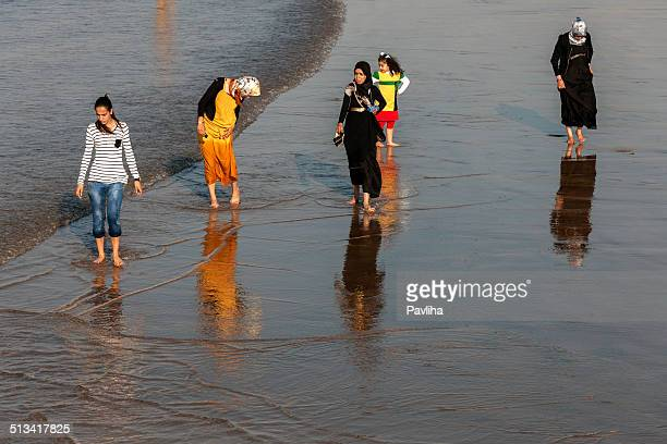 moroccan women and children at the kasbah beach, africa - muslim woman beach stock photos and pictures