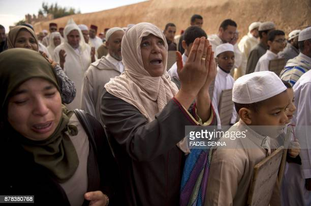 Moroccan women and children head to the Great Mosque of Sale to pray for rain on November 24 2017 near the capital of Rabat Parched Morocco which is...