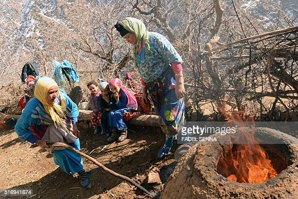Moroccan women make bread in Taghzirt an isolated village in the elHaouz province in the High Atlas Mountains south of Marrakesh on March 4 2016 When...