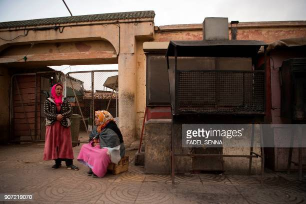 Moroccan women sit on a street during a general strike ahead of a demonstration against economic marginalisation on January 19 in the northeastern...