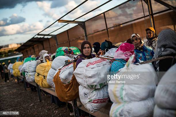 Moroccan women wait with their packages at the 'Barrio Chino' border crossing point between Melilla and Morocco on January 20 2015 in Melilla Spain...