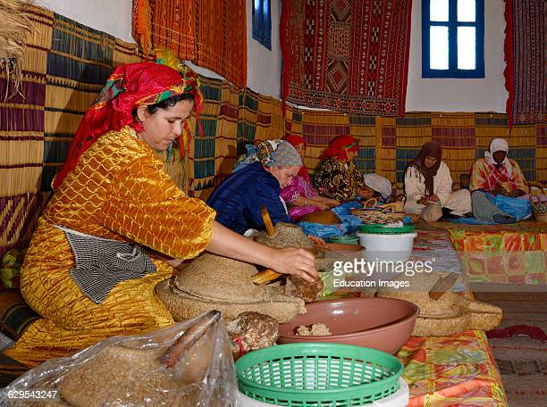 Moroccan womens cooperative at Afous Argane making argan oil by hand in a production line