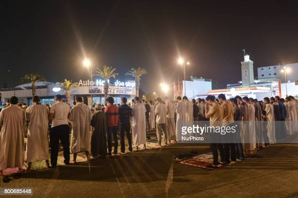 Moroccan worshipers perform the last 'Tarawih' prayer during the Islamic holy month of Ramadan in Rabat city center The moonsighting committee in...