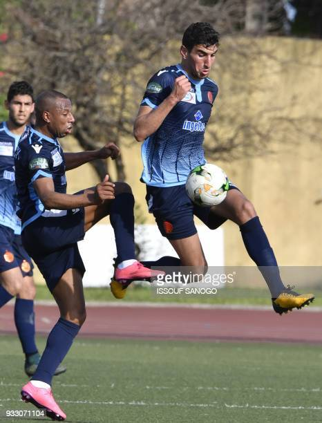 Moroccan Wydad Athletic club's Brahim Nakach and Haddadi Faissal vie during the CAF Champions league football match between Williamsville Athletic...