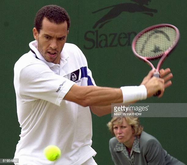 Moroccan Younes El Aynaoui eyes the ball for a backhand slice during his thirdround match at the Wimbledon championships against Belarus Vladimir...