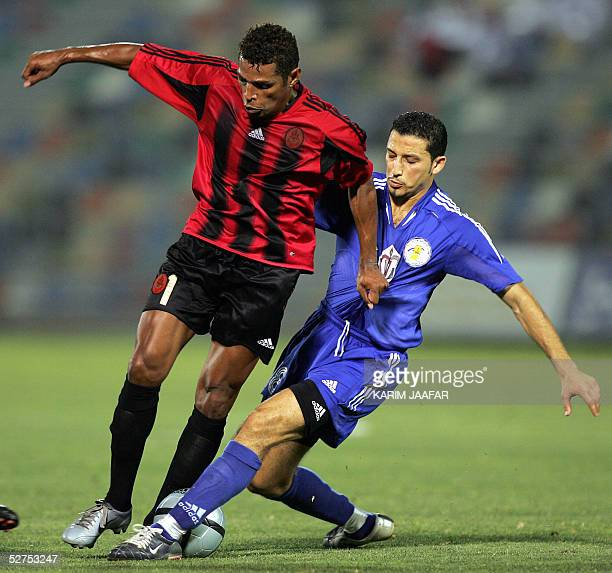Moroccan Yousef Rossi of AlKhor fights for the ball against Brazilian Sony Anderson of alRayyan during their Crown Prince Cup match in Doha 03 May...