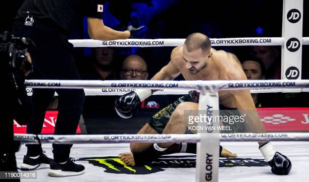 Moroccan-born Dutch kickboxer Badr Hari gives up after being injured during his fight against Dutch kickboxer Rico Verhoeven as part of the kick...