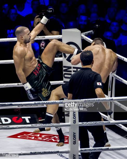 Moroccan-born Dutch kickboxer Badr Hari injures himself during a rematch against Dutch kickboxer Rico Verhoeven as part of the kick boxing event...
