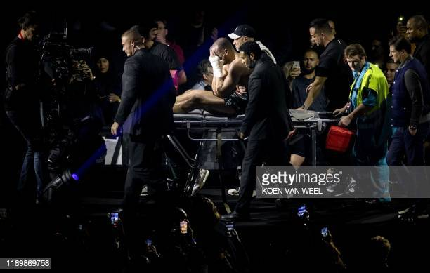 Moroccanborn Dutch kickboxer Badr Hari leaves after being injured during the rematch against Dutch kickboxer Rico Verhoeven as part of the kick...