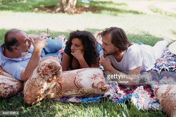 Moroccanborn writer Tahar Ben Jelloun author of La Nuit Sacree discussing with Tunisianborn actress Amina Annabi and Panamanian actor Miguel Bose on...